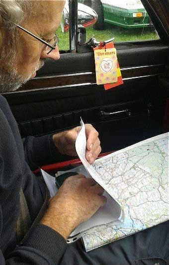 Photo of Navigator reading map