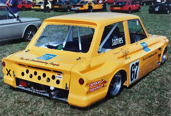Rear view of bright yellow competition Imp without lid in place