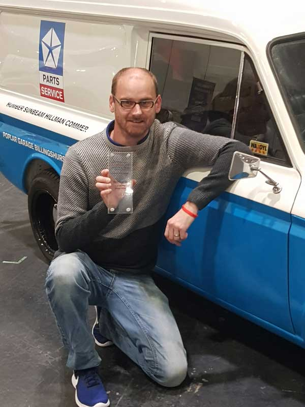 Pete with trophy by his Imp van in blue and white livery